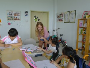 Oliva talking to children at the Shenyang City Orphanage