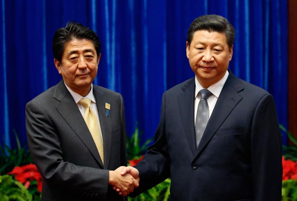 Xi Jinping and Shinzo Abe shake hands at November 2014 APEC Summit.